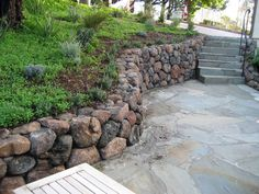 A Sonoma Fieldstone retaining wall and flagstone patio built by Aztec Masonry.