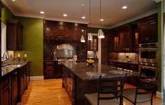 I love the shade of green against the dark wood. Kitchen   Milestone Custom Homes   Greenville, SC