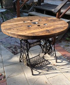 Made use of an old sewing Machine base and a spool. Great piece for the porch OR dining room