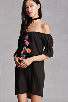 a803f66180d A woven shift dress featuring multicolored pom poms and tasseled braids on  the front
