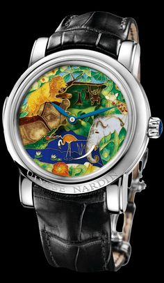 ♥ Beautiful! ♥ The Safari Jaquemarts Minute Repeater is fitted with 2 cloisonné dials which give this collector's timepiece its 3D appearance. The dials are mounted on top of each other with space in between to reveal a little fish being caught in a crocodile's jaws. Activation of the minute repeater lever causes the lion's paw to stretch forward & reach for the monkey. The monkey swings back & forth from his branch. The intricate cloisonné work is a work of extraordinary beauty & quality