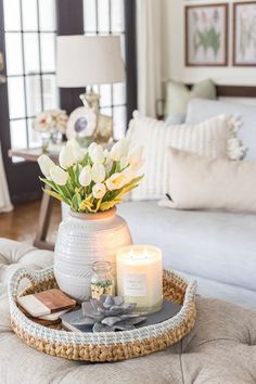 Simple Spring Home Tour | Neutral living room decorated with small floral touches for spring. #springdecor #livingroom