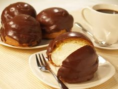 Bossche Bollen, from the province of Noord-Brabant; chocolate on the outside, crispy dough and whipped cream on the inside, yam!