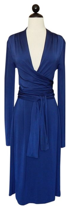 Hugo Boss Wrap Look Tie Belt Stretch Dress. Free shipping and guaranteed authenticity on Hugo Boss Wrap Look Tie Belt Stretch DressDETAILS:  Sexy wrap style bodice that ties and bel...