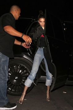 Stepping out: Kendall rocked transparent boots with cuffed jeans