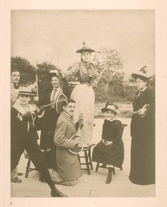 """Jeanne Pouquet, standing on the chair, was one of the models for Gilberte. Marcel Proust is serenading her, with a """"guitar,"""" on the Boulevard Bineau à Neuilly-sur-Seine in 1891or 1892.  (bookhaven.stanford.edu/)"""