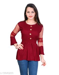 Checkout this latest Tops & Tunics Product Name: *Sniffy kids party wear solid top for girls* Fabric: Cotton Blend Sleeve Length: Three-Quarter Sleeves Pattern: Self-Design Multipack: Single Sizes:  10-11 Years, 11-12 Years, 12-13 Years, 13-14 Years, 14-15 Years (Bust Size: 33 in, Length Size: 23 in, Waist Size: 29 in)  15-16 Years (Bust Size: 34 in, Length Size: 24 in, Waist Size: 30 in)  Free Size Country of Origin: China Easy Returns Available In Case Of Any Issue   Catalog Rating: ★3.9 (1566)  Catalog Name: Princess Stylus Girls Tops & Tunics CatalogID_2685034 C62-SC1142 Code: 513-13640233-588