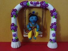 Lord krishna on a Jhula. made with polymer clay