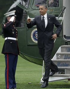 U.S. President Barack Obama steps out from the Marine One helicopter on the South Lawn of the White House upon his return to Washington May 2, 2012 after a trip to Afghanistan.