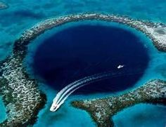 the great blue hole in belize...largest sinkhole in the world. kind of terrifying and beautiful at once.