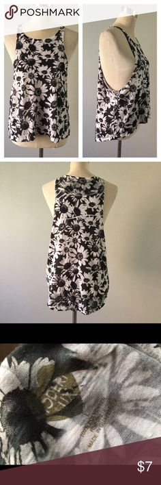 Modern Lux Daisy Black & White Muscle Tank Modern Lux Daisy Black & White Muscle Tank. Marked as a large, fits like a medium. In good condition. Very slight pilling, still very wearable. Please see pictures. Thank you for looking at listing. Feel free to ask questions :)!   ✨⭐️️Bundle and save!⭐️✨10% off 2 items, 20% off 3 items & 30% off 5+ items!   •Sorry no trades. •No modeling. •No Low balls 🙅🏻 please and thank you!  (AC) modern lux Tops Tank Tops