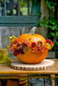 Pumpkin Vessels  Earthy Fall Chrysanthemums & Pumpkins make a cheery center piece       I'm always looking for new way to design fl...