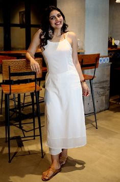 Elegant strappy white kurta with front stitch. Front slit and kantha stitch details steals theshow Elegant strappy white kurta with front stitch. Front slit and kantha stitch details steals theshow Dress Indian Style, Indian Dresses, Indian Outfits, Indian Wear, Indian Designer Outfits, Designer Dresses, Casual Indian Fashion, White Kurta, Kurta Designs Women