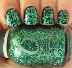 Orly Mermaid Tale. I've been wearing this on my toes. Looks cool over all colors.