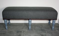 Gorgeous soft grey wool covered stool with painted carved legs.