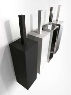 Toilet brush for both wall and floor. Available in polished, brushed, white and black stainless steel. Available at Astro Design, Ottawa Canada
