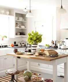 Discover top kitchen storage ideas from 30 beautiful, modern kitchens. Get ideas for cabinets, islands, shelving and more! Kitchen Tops, Kitchen Dining, Kitchen Decor, Kitchen Island, Island Table, Eclectic Kitchen, Open Kitchen, Country Kitchen, Kitchen Styling
