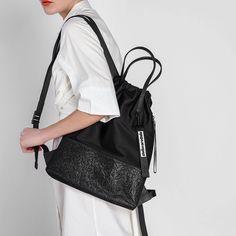 Black Mesh Detail Drawstring Backpack |CHARLES & KEITH