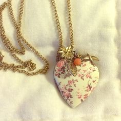 Peach long locket necklace Peach long locket necklace with charms on it Urban Outfitters Jewelry Necklaces