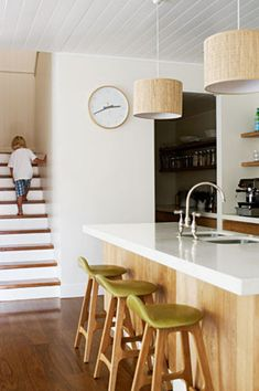 Wood + white kitchen on Inside Out - love the Erik Buch bar stools from Great Dane.