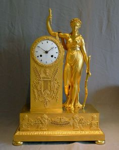 A fabulous antique French First Empire ormolu mantel clock of Diana. She carries a bow in her left hand and a prominent applied ormolu mount on the side of the clock housing has a reperesentation of arrows. There are further mounts to the front of the case with quivers for arrows held by swans on a lyre. However she also carries a torch in her right hand, has roses in her hair rather than the more usual crescent moon and there are mounts with cupids wearing butterfly wings. France circa…