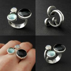 A new open ring with 3 stones, onyx, sky blue topaz, rainbow moonstone.