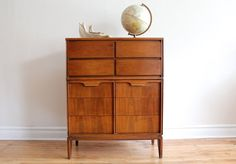 "MCM highboy dresser by Basic-Witz Furniture  Gorgeous grain on this refinished top. Five long drawers - middle drawer has dividers. Brass accents.  45.5"" Tall x 18"" Depth x 36"" ..."