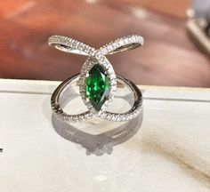 Adding color can turn a bridal ring into a fashion piece! This Gabriel&CO beauty is set with a Tsavorite and diamonds for a bold new look.