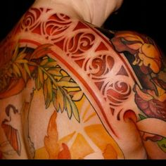 Tattoo by Jeff Gogue. Love the solid lines and colours of this piece.