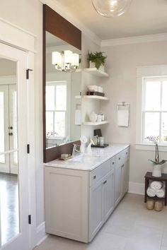 Light Gray Bathroom with marble countertop and dark wood - Terracotta Properties
