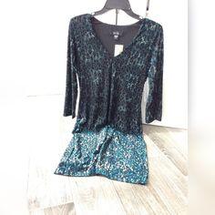 Knee length dress Black and blue knee length cheetah print dress. 60% polyester. Karen Kane Dresses