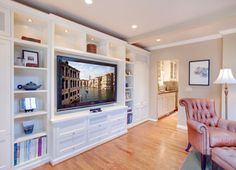 Family Room built-ins for tv, with cabinetry below for hidden cable box, dvr/dvd, etc...