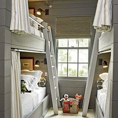 These bunk beds' safety rails double as tracks for ladders that slide along the beds. Neat bunk room idea! Coastalliving.com
