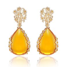 These one-of-a-type Chopard sapphire and fire opal earrings comply with the collection's pattern for flowing, supple, openwork designs based mostly on rounded shapes. These earrings are crafted from rose gold and have two super fire opals totaling a staggering 113.8cts, accentuated with Mandarin garnet cabochons, colored sapphire cabochons and brilliant-cut diamonds, which are total weight 3.1cts.