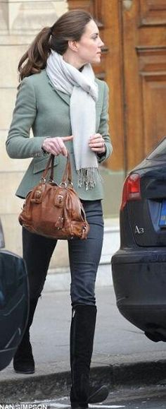 Kate MIddleton wearing skinny jeans, black suede boots, a scarf, the most beautiful Custom Estate blazer by Ralph Lauren and carrying her brown Prada bag, her hair up in a pony-tail. Casual perfection.