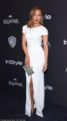 Picture perfect: Jennifer Lopez looked incredible in a white gown with a subtle side split as she kept the party going at the Beverly Hills Hilton after the 2016 Golden Globes on Sunday