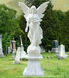 This beautiful angel statue, carrying a floral arrangement, represents peace and love. Statue Specifications: 72t x 41w . Base Specifications: 24t x 31d x 21w
