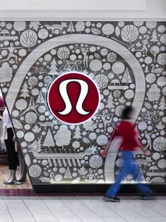 Quadrangle Architects together with the Lululemon Interiors Team and artist Jason Blower, created a 380 square foot graphic facade of custom sandblasted wood panels for a Lululemon store located in the Southgate Shopping Mall in Edmonton, Canada.