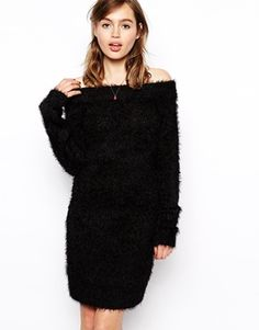 "Fuzzy, knobbly, pet me black sweater dress fills the season's requirement of ""Knit, knit, knit!"" in a throwback, sexy way. Off-the-shoulder and fashion strong as a straight dress, a belted look, over leggings or skinny jeans, pushing the proportions envelope over full midi skirts, and all for $81.26. Win! ASOS Knitted Fluffy Dress With Bardot Neck"