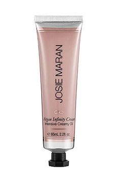 "Josie Maran Argan Infinity Cream is basically anything you want it to be. It smooths flyaways and split ends, hydrates dry lips and cuticles, works as a primer or highlighter, and turns powder makeup into cream. Or, ""tap it under the eyes and around fine lines to revive concealer and reconstitute dry makeup,"" says Surratt."