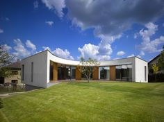 The plot of land on which the new house was designed is situated in a residential area of villas on the northern bank of Revnice above the valley of the river Berounka in the Czech Republic. The mass of the house blends into the terrain so that it re