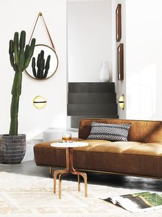 Modern living room with LED sconce on Thou Swell @thouswellblog