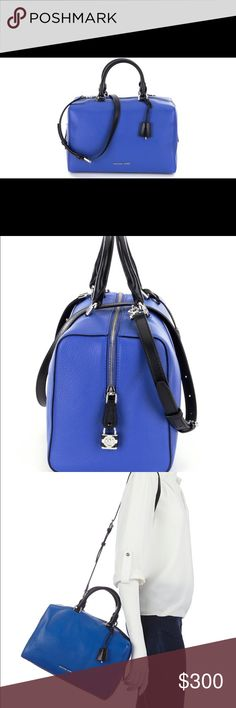 """MK electric blue large Dome Satchel PRODUCT DETAILS: MICHAEL Michael Kors. Featured in electric blue Large dome satchel Double rolled handles with 4½"""" drop Detachable, adjustable crossbody strap Top zip closure Allover signature """"MK"""" monogram print Detachable leather key charm pouch Metal logo letters at lower front Shiny rhodium metal hardware Exterior: one back zip pocket Interior: one zip pocket, three open pockets, one cellphone pocket, and a dog leash keyfob 12"""" W x 8½"""" H x 6½"""" D…"""