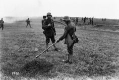 German infantrymen practising with flame thrower at an infantry training school on the Western Front.