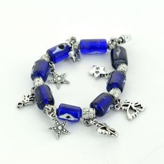 This Anatolian, Evil Eye Elastic Charm Bracelet -  Dark Blue-Long Glass Ornament measures 3 inches wide and features hand-crafted glass evil eyes.