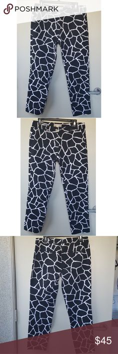 """MICHAEL Kors // Giraffe Print Ankle Pants MICHAEL MICHAEL Kors Giraffe Print Ankle Pants Black / White  A distinctive animal print defines slim pants cleanly tailored from crisp cotton poplin infused with a bit of silk for a polished look.  Approx. inseam: 29"""" Zip fly with button closure. Slant front pockets; back welt pockets. Cotton/spandex; machine wash.  *Tag has been cut out* MICHAEL Michael Kors Pants Ankle & Cropped"""