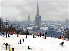 A lovely photo of people playing in the snow on Mousehold Heath by Rob Howarth | BBC Norfolk