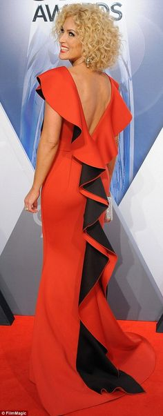 She's red hot for sure:Kimberly Schlapman of Little Big Town wore a scarlet dress with bl...