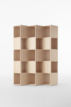 Fold is a minimalist design created by Tokyo-based design firm, Nendo. The shelving unit is composed of interlocking wooden boards that are oriented in different positions. The Japanese manufacturer Conde House is responsible for its manufacture. Wood Furniture, Modern Furniture, Furniture Design, Smart Furniture, Etagere Design, Modern Bookshelf, Unique Bookshelves, Regal Design, Shelf Design