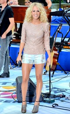 Carrie Underwood gets leggy at a Today show performance with gold embroidered cutoffs, a sequined champagne top, shimmering ankle-strap booties and gold chandelier earrings.